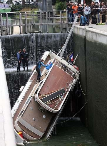 Cell in Canal - boat upended